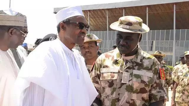 Nigeria's Chief of Army, Lt. General Tukur Yusuf Buratai: Seen here with president Muhammadu Buhari